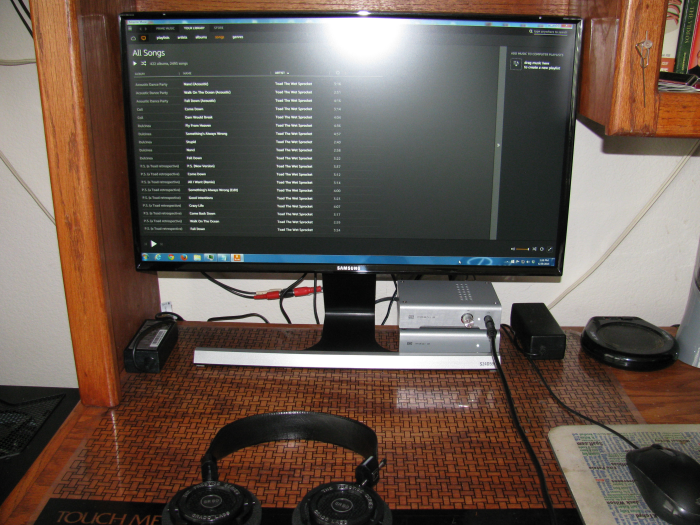 Schiit Modi 2 and Magni 2 shown under the right side of the monitor
